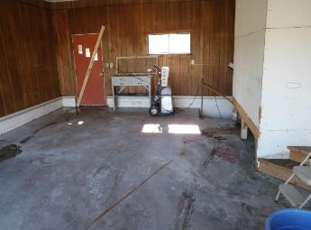 Gross filth garage after clean-up of dog feces & urine