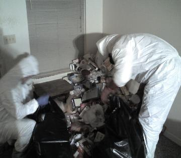 Bowdecon staff removing trash from gross filth apartment diining room
