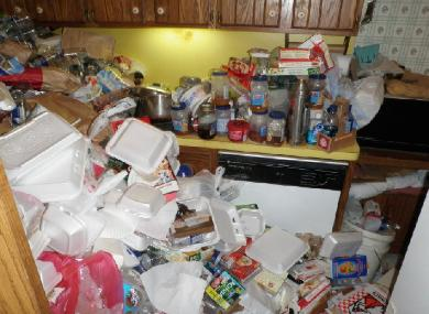 Trash filling hoarder's kitchen