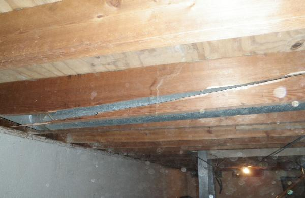 Floor joist broken from weight of hoard