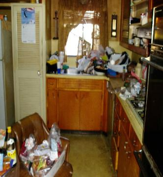Trash & rotting food on kitchen counters of hoarding house